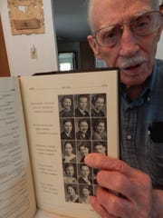 George Masson, 96, points to a yearbook picture of Josephine Turner, who graduated from Washington High School with him in 1935. Masson knew Kathryn's sister, brother and father, but not her.
