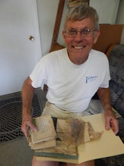 Terry Philips holds the water-stained papers that are the evidence of Kathryn's joys and struggles from 1950 to 1956.