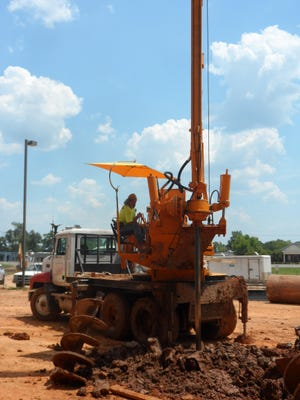 A worker for Ground Hog Drilling of Houston, Texas, drills a hole for a pier for the new foundation of the Rapides Parish Coliseum on Monday. The overall Coliseum renovation project is about 6 to 7 percent complete.