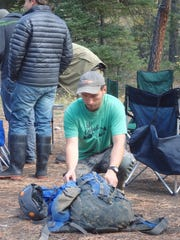 Taylor Woods prepares his pack for the restoration project.