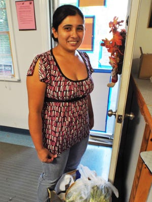 Heidy Perez of Wappingers Falls relies on food from the Food Pantry at Zion Episcopal Church in Wappingers Falls to keep her family of six fed.