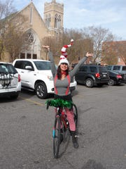 Regina Berry, one of the organizers of the Christmas Cruiser Ride to aid Main Street Mission in Pineville, was decked in holiday attire for the event.