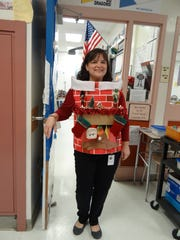 Kelly Gandy won the Ugly Sweater Contest sponsored by Lakeside Middle School's chapter of the National Junior Honor Society.