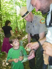 Grandfather Mountain Ranger Andy Sicard discusses plant life on guided hike.