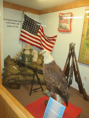 A new exhibit at the Phillips County Museum features a World War I machine gun and an antique mounted bald eagle.