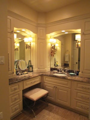 Lighting and new counter tops can update a bathroom's look.