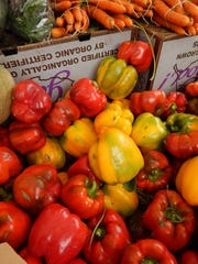 At the Ojai farmers market, fresh organic red bell peppers from John Givens Farm in Santa Barbara are just waiting to be roasted and frozen for the winter.