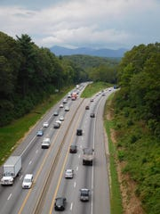 Interstate 26 rolls under the Blue Ridge Parkway bridge. The state Department of Transportation proposes to widen I-26 to eight lanes here.