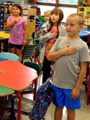 Martin Luther Elementary School students Olivia Leary, Tala Long, Alex Kempf, Savannah Knatzke and JJ Minzlaff stand every morning with the rest of their classmates to say the Pledge of Allegiance.