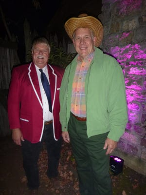 Greeting guests as they arrived at James White's Fort for the HearthScares Ball were fort executive director Sam Maynard as Captain Kangaroo with his sidekick Alan Williams as Mr. Green Jeans.