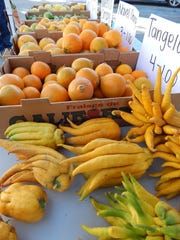 A sure sign of the season at the downtown Ventura farmers market is when the Buddha's hands are offered among the citrus from Vanoni Farm in Saticoy. The oddly shaped citron is used for its peel, which is candied.