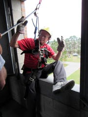 TALL_Glenn Nelson before he repels out of a window on Public Safety Day. Gle