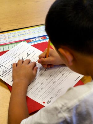 Americans are debating whether the nation's children should be studying cursive.