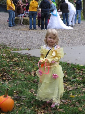 """This princess is ready to play 'Pumpkin Ring Toss' at """"Trunk or Treat"""" at Diamond Lake on Saturday, Oct. 7."""