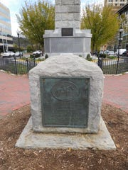 The Lee plaque, foreground, sits a few feet to the west of Vance Monument in downtown.