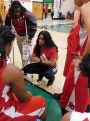 Port Barre girls basketball coach Keke Veal explains some adjustments during Thursday's first-round parish tournament game with Eunice High.