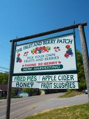 Sign for the Fruit and Berry Patch off McCloud Road in Halls.
