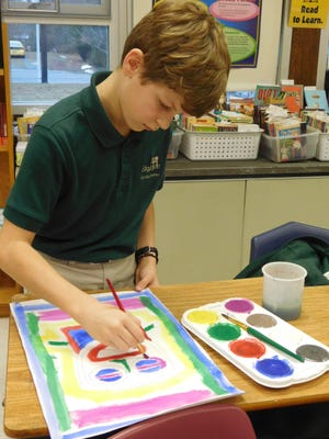 Holland Young, 11, of Bridgeton, a fifth grader at Edgarton Christian Academy, imitates the paintings of renowned artist Tyree Guyton during IreneAnderson's art class as part of the celebration of Black History Month.