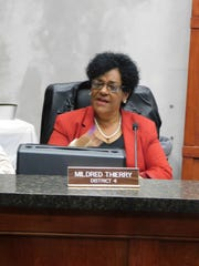 Landry Parish Council member Mildred Thierry discusses sewage rate hikes at Wednesday night's meeting.