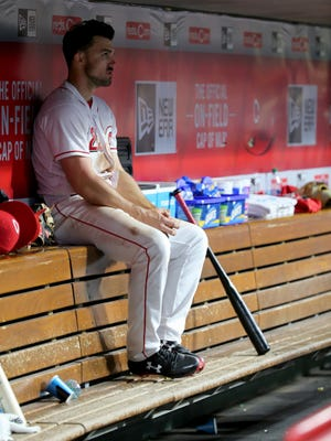 Cincinnati Reds left fielder Adam Duvall (23) sits in the dugout in the seventh inning during a National League baseball game between the Milwaukee Brewers and the Cincinnati Reds, Tuesday, May 1, 2018, at Great American Ball Park in Cincinnati. Milwaukee won 7-6
