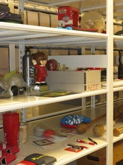 Shelves of Johnnie artifacts are show at SJU archives.