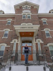 Developer Eric Farrell in front of the renovated Liberty House on North Avenue.