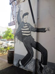 A mural of Elvis Presley is in downtown Tupelo, the Mississippi town in which he was born.