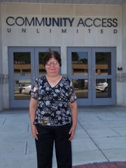 Marcella Truppa, a person with disabilities, stands