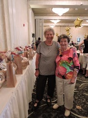 Long-time volunteers Ruth Mirrer of Chatham and Joan Abelson of New Providence look over the raffle baskets during SAGE Eldercare's annual luncheon held July 17 at The Grand Summit Hotel. The event honors the volunteers who support the many programs of SAGE Eldercare, a unique community resource for older adults and caregivers. To learn more about the volunteer opportunities at SAGE, please call Marianne Kranz at 908.598.5514, or email mkranz@sageeldercare.org. The luncheon was sponsored by PNC Wealth Management, Home Care Assistance, and The Grand Summit Hotel.