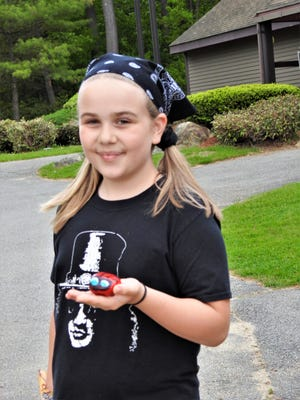 Keili Richards spent a warm, sunny day trying to catch frogs at Dunn Pond in Gardner. Keili catches and releases the frogs back into the wild. While catching frogs, she found a painted stone that looked remarkably like a ladybug.