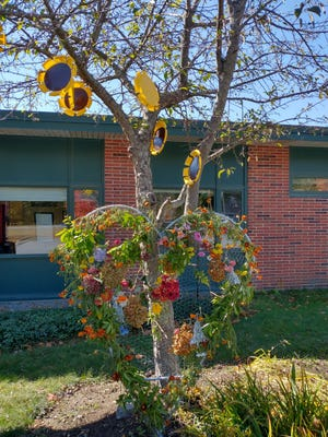 As part of the annual Peace Pole Celebration at Houghton Elementary School, students and parents brought flowers that were formed into a heart. This year's celebration is themed, 'Gotta let your soul shine, shine till the break of day,' A video will be posted on YouTube.