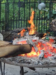 Backyard fire pits are gathering places for families and friends.