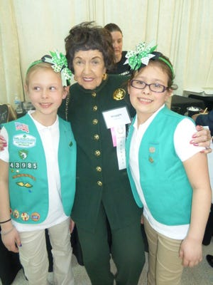 Top cookie sellers Gabby Chavez (left) and Emily Wright, both from Girl Scouts Troop 13985, hang out with Cookie Gala Honorary Co-Chair and Bloomfield Hills resident Maggie Allesee.