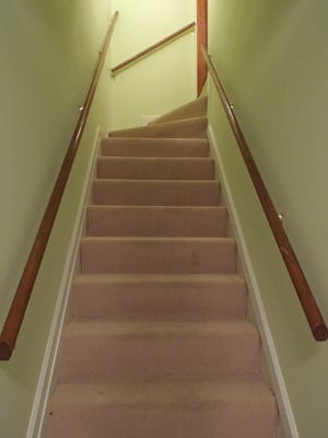 Fitting staircases with banisters along both sides helps prevent falls in multi-level homes.