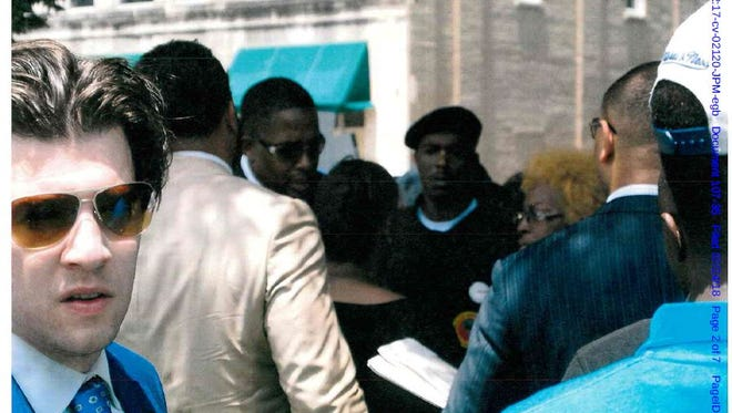 This photo was included among the exhibits released during the American Civil Liberties Union lawsuit against the city of Memphis. The ACLU says it was taken by a plainclothes police officer during a protest outside The Commercial Appeal's Union Avenue building on July 13, 2016. It was entered into court records. After online publication of the photo, the man in the blue suit and sunglasses identified himself. He's Aaron Neglia, an activist and lawyer with the firm Horne & Wells.