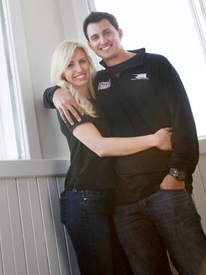 Graham Rahal and Courtney Force at Rick's Cafe Boatyard Wednesday, March 5, 2014.  They are racing;s new power couple.