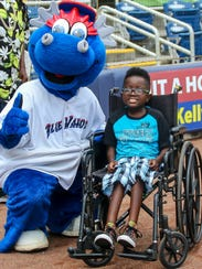 Kazoo poses for a photo with Michael Griffin, 9, during