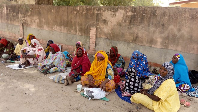 Internally displaced Nigerian women beg near their camp in Maiduguri in Borno State, an area where Boko Haram terrorists are active.