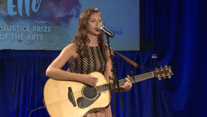 """Kathleen Lonski performed """"Don't Let Them In"""" under the stage name Kathleen Elle at the 10th anniversary """"Elfenworks In Harmony With Hope"""" awards ceremony in San Francisco in September."""