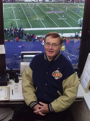 Van Miller in the broadcast booth, shortly before his retirement in 2003.