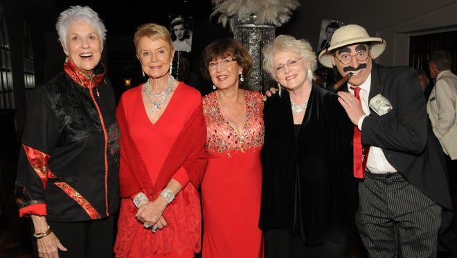 "From left: Rachel Druten, Donna MacMillan, Victory Grund, Linda Baughman and ""Groucho Marx."""