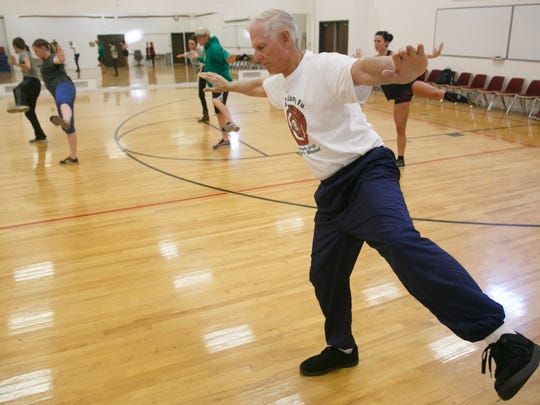 Gary Whitehead leads his students through a series of moves during his tai chi class on the campus of Dixie State University Wednesday, Oct. 21, 2015.