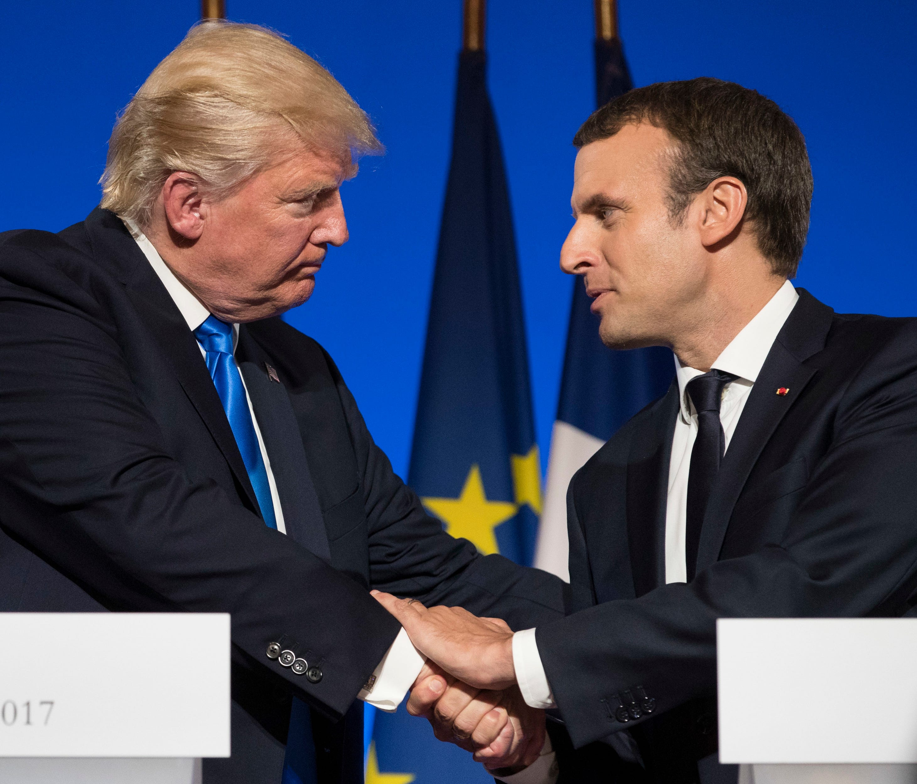 President Trump and French President Emmanuel Macron shake hands at the conclusion of a joint news conference at the Elysee Palace in Paris.