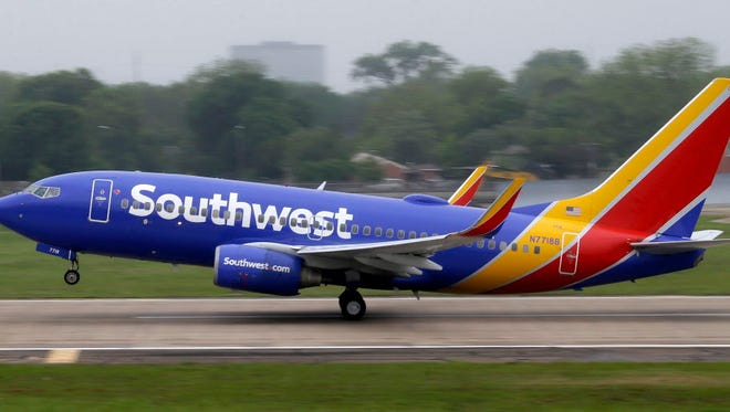 A Southwest Airlines jet takes off from a runway at Love Field in Dallas on April 23, 2015. A Southwest flight was diverted to Kansas City on Sunday because of suspicious passengers, but no bombs were found and the flight resumed.