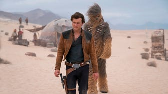 Joonas Suotamo as Chewbacca, here with Alden Ehrenreich as Han Solo, required that many fans be blowing in his face in between takes.