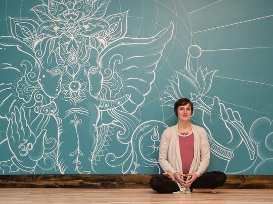 Eva Whipple, owner of Soul Yoga Studio poses for a photo on Thursday, Feb. 22, 2018.