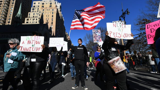 Protestors march along Central Park South during the 'Not My Presidents Day' rally in New York City on Feb. 21, 2017.