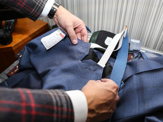 Savile Row master tailor Steven Hitchcock takes measurements