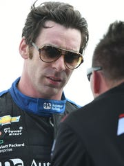 Simon Pagenaud debriefs after his morning practice on Friday for the Honda Indy 200 at Mid-Ohio.