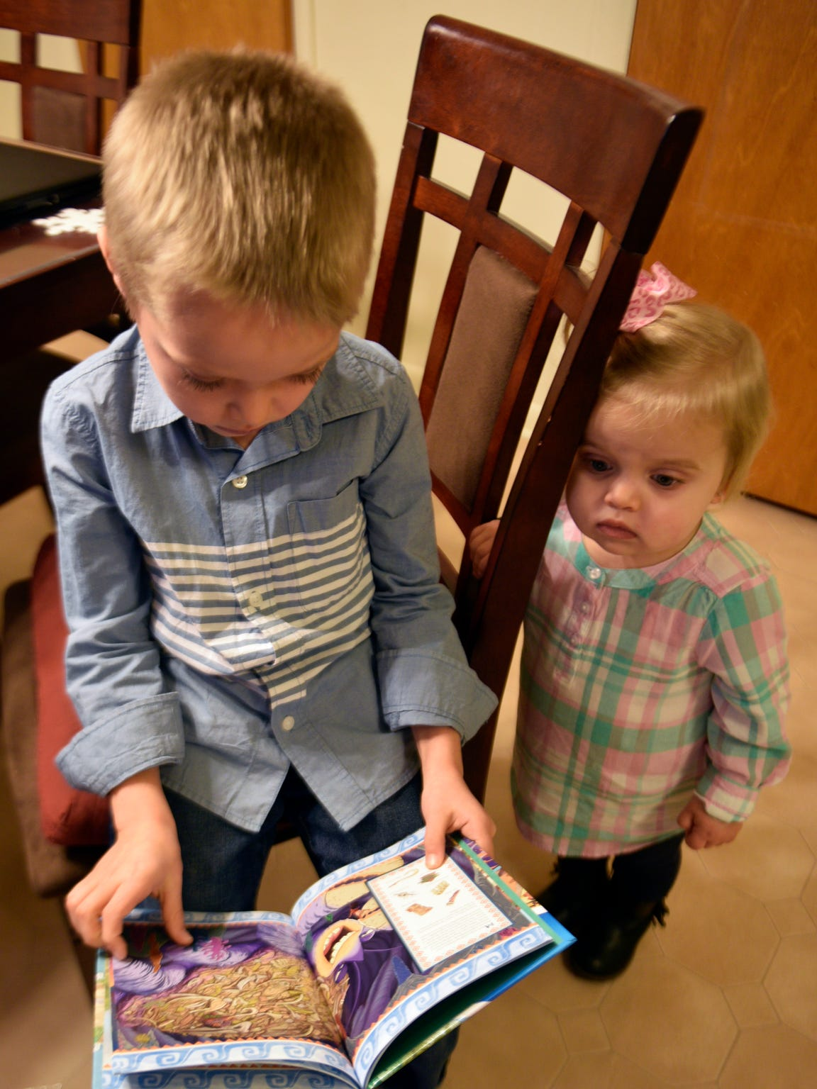 Conner Keiper, 8, reads to his younger sister, Kenleigh,